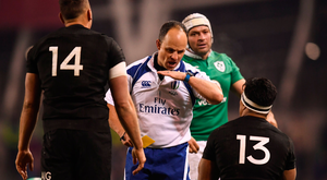 Malakai Fekitoa of New Zealand receives a yellow card from referee Jaco Peyper