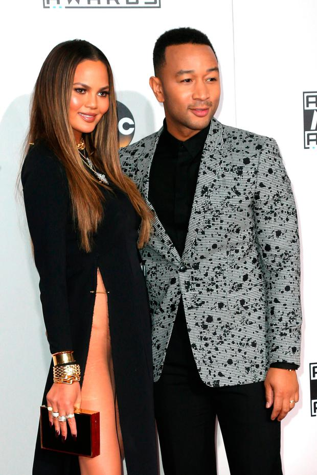 Model Chrissy Teigen (L) and singer-songwriter John Legend attend the 2016 American Music Awards at Microsoft Theater on November 20, 2016 in Los Angeles, California. (Photo by Frederick M. Brown/Getty Images)