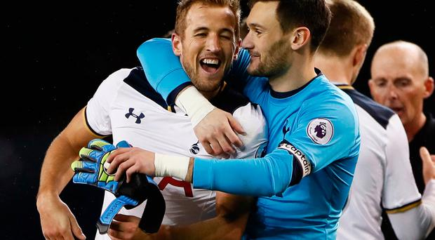 Tottenham's Harry Kane and Hugo Lloris celebrate after the match