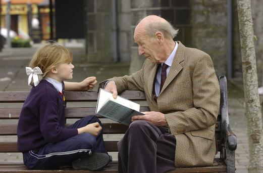 Trevor reads to Nadia Rodgers (8) during Listowel Writers' Week in 2003 Picture: Domnick Walsh Tralee