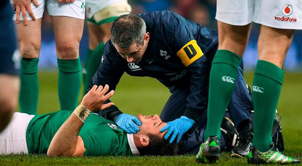 Robbie Henshaw receives medical attention during the Autumn International match between Ireland and New Zealand at the Aviva Stadium in Dublin. Photo by Brendan Moran/Sportsfile