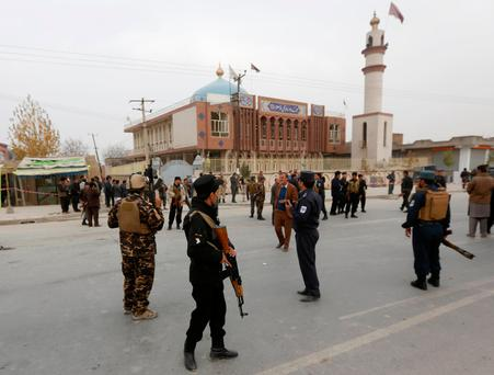 Afghan security forces keep watch in front of the mosque where the explosion happened Photo: REUTERS/Omar Sobhani