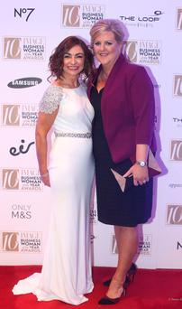 Pamela Quinn, right, MD of Kuehne and Nagel, who was named as the overall image businesswoman of the year and Oonagh O'Hagan, founder and MD of Meaghers Pharmacy group, who was named entrepreneur of the year at the 2016 IMAGE Businesswoman of the Year Awards in Dublin. Picture credit; Damien Eagers