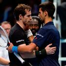Andy Murray with Novak Djokovic after the final. Photo: Reuters