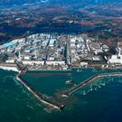 This aerial photo shows Fukushima Dai-ichi nuclear power plant in Okuma, Fukushima Prefecture, following a strong earthquake hit off the coast of Fukushima, northern Japan (Kyodo News via AP)