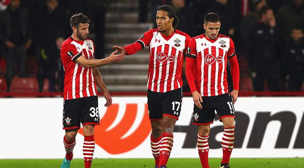 SOUTHAMPTON, ENGLAND - NOVEMBER 03: Virgil van Dijk of Southampton (C) celebrates with Sam McQueen (L) and Dusan Tadic (R) after scoring his team's first goal during the UEFA Europa League Group K match between Southampton FC and FC Internazionale Milano at St Mary's Stadium on November 3, 2016 in Southampton, England. (Photo by Ian Walton/Getty Images)