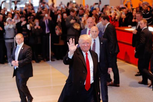 U.S. President elect Donald Trump reacts to a crowd gathered in the lobby of the New York Times building after a meeting in New York, U.S. Picture: REUTERS/Lucas Jackson