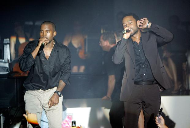 Recording artists John Legend (R) and Kanye West perform at Kanye West's concert held exclusively for American Express card members at the Nokia Theatre August 29, 2006 in New York City. (Photo by Scott Gries/Getty Images For American Express)