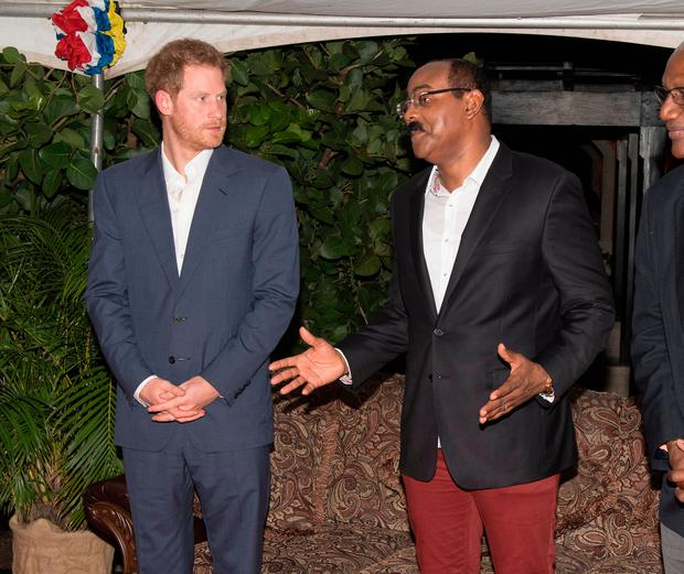 Prince Harry attends a reception hosted by Gaston Browne, Prime Minister of Antigua and Barbuda (R) on November 21, 2016 in Barnacle Point, Antigua. Prince Harry's visit to The Caribbean marks the 35th Anniversary of Independence in Antigua and Barbuda and the 50th Anniversary of Independence in Barbados and Guyana. (Photo by Paul Edwards - WPA Pool/Getty Images)