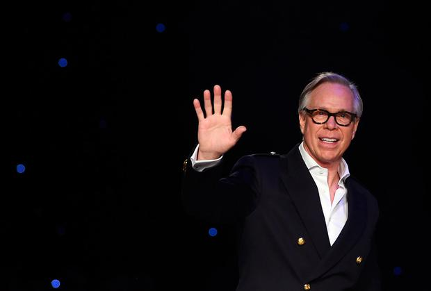 US designer Tommy Hilfiger greets the audience after presenting his creations during the Fall 2016 New York Fashion Week