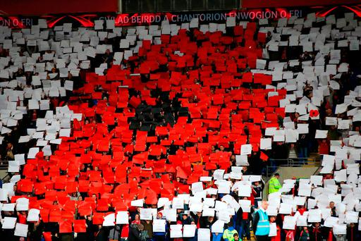 File photo dated 12-11-2016 of Remembrance Day tributes in the stands PRESS ASSOCIATION Photo. Issue date: Wednesday November 23, 2016. FIFA's disciplinary committee has announced the opening of proceedings against the Irish Football Association and the Football Association of Wales in relation to incidents involving the display of poppy symbols during recent internationals. See PA story SOCCER Poppy. Photo credit should read Nick Potts/PA Wire.