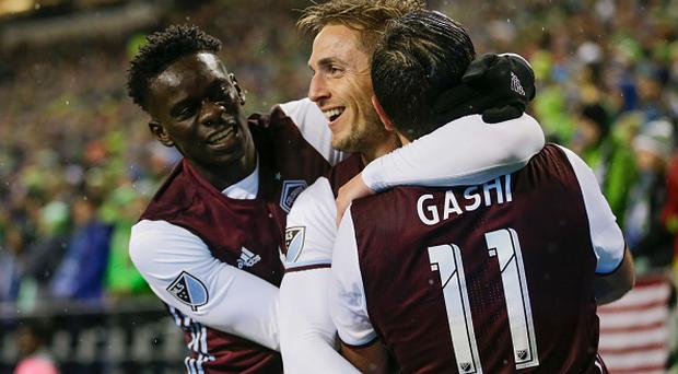 SEATTLE, WA - NOVEMBER 22: From left, Dominique Badji #14 of the Colorado Rapids, Kevin Doyle #9 of the Colorado Rapids and Shkelzen Gashi #11 celebrate a goal by Doyle during the first half of a match in the first leg of the Western Conference Finals at CenturyLink Field on November 22, 2016 in Seattle, Washington. (Photo by Stephen Brashear/Getty Images)