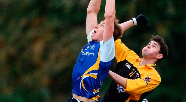 Coláiste Éanna's Luke Corcoran in an aerial duel with Paul Cunningham of St Pat's CS Navan during yesterday's Top Oil Leinster Post-Primary Schools SFC first round clash. Photo by Eóin Noonan/Sportsfile