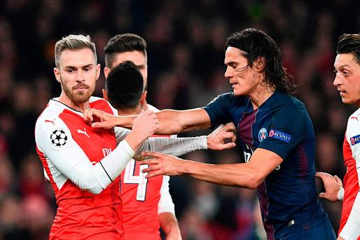 Paris Saint-Germain's Uruguayan forward Edinson Cavani (2R) scuffles with Arsenal's Welsh midfielder Aaron Ramsey (L) after Arsenal were awarded a penalty during the UEFA Champions League group A football match between Arsenal and Paris Saint-Germain at the Emirates Stadium last night
