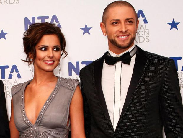L-R Cheryl and Brian Friedman pose with the most popular talent show award awarded to X Factor in the press room at the National Television Awards held the at The O2 Arena on January 20, 2010 in London, England. (Photo by Dave Hogan/Getty Images)