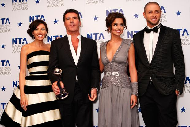 L-R Dannii Minogue, Simon Cowell, Cheryl Cole and Brian Friedman pose with the most popular talent show award awarded to X Factor in the press room at the National Television Awards held the at The O2 Arena on January 20, 2010 in London, England. (Photo by Dave Hogan/Getty Images)