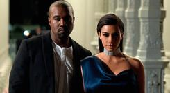 Recording artist Kanye West (L) and TV personality Kim Kardashian attend the 2014 LACMA Art + Film Gala honoring Barbara Kruger and Quentin Tarantino presented by Gucci at LACMA on November 1, 2014 in Los Angeles, California. (Photo by Jason Kempin/Getty Images for LACMA)