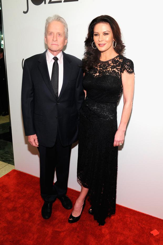 Actors Michael Douglas (L) and Catherine Zeta-Jones attend the opening of the Mica and Ahmet Ertegun Atrium at Jazz at Lincoln Center on December 17, 2015 in New York City. (Photo by Craig Barritt/Getty Images for Jazz at Lincoln Center)