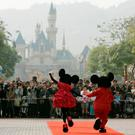 Mickey Mouse and Minnie Mouse characters greet visitors with their latest Year of the Mouse costumes at Hong Kong Disneyland, China in January 21, 2008. REUTERS/Bobby Yip/File