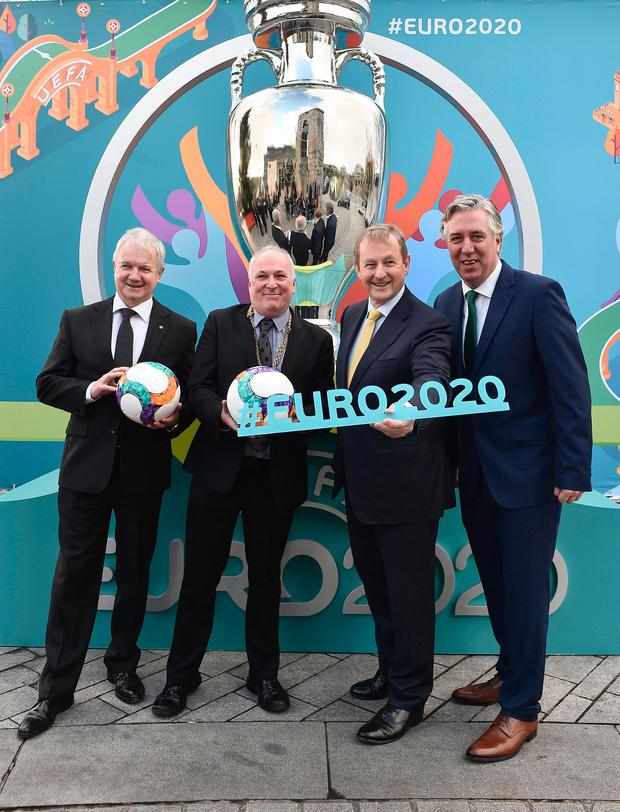 (From left) UEFA's Frantisek Laurinec, Deputy Mayor Dermot Lacey, Taoiseach Enda Kenny and the FAI's John Delaney. Photo: Sportsfile