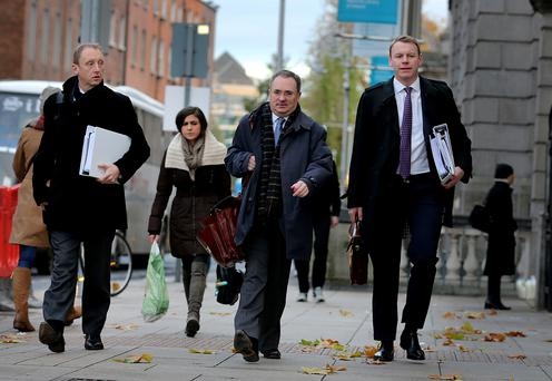 Nama CEO Brendan McDonagh, head of residential delivery John Collison and chief financial officer John Coleman heading into the Public Accounts Committee meeting. Photo: Tom Burke