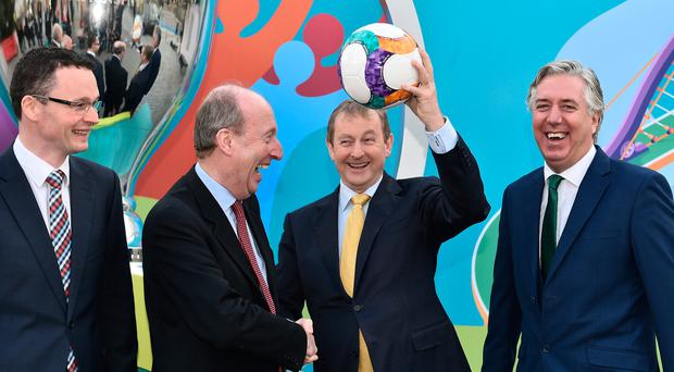 Taoiseach Enda Kenny with Tourism and Sport Minister Patrick O'Donovan, Sports Minister Shane Ross and Football Association of Ireland chief executive John Delaney at the Uefa Euro 2020 host city logo launch at the CHQ Building in Dublin yesterday. Photo David Maher