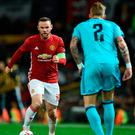 Manchester United's Wayne Rooney (L) takes on Feyenoord defender Rick Karsdorp. Photo: Getty Images
