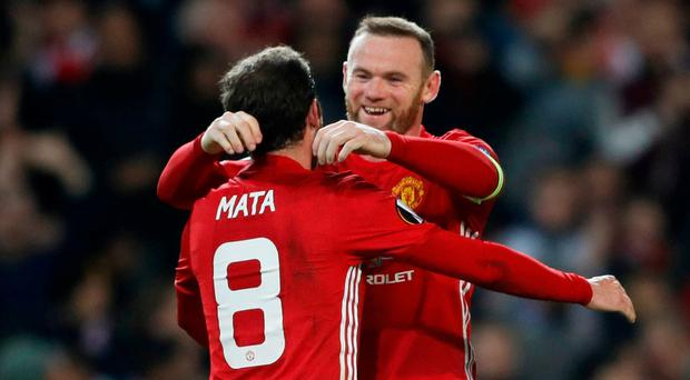 Manchester United's Juan Mata celebrates scoring their second goal with Wayne Rooney. Action Images via Reuters / Carl Recine