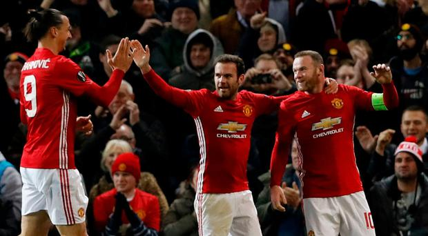 Manchester United's Wayne Rooney celebrates with Zlatan Ibrahimovic and Juan Mata
