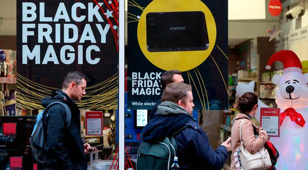 Shoppers walk past Black Friday signs on Jervis Street, Dublin. Brian Lawless/PA Wire