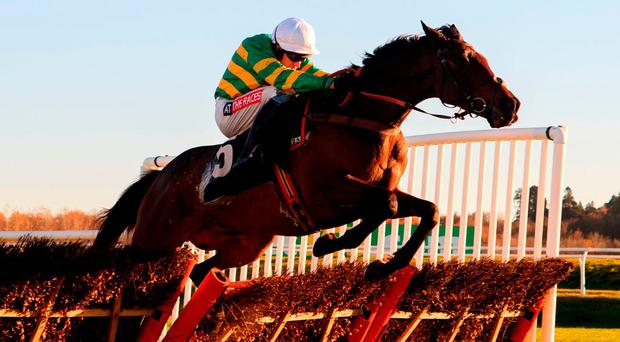 Barry Geraghty guides Unowhatimeanharry, owned by his boss JP McManus and trained by Harry Fry, over the last flight on the way to capturing the bet365 Long Distance Hurdle at Newbury yesterday – the Meath rider went on to record a 53/1 treble courtesy of victories aboard the Nicky Henderson pair, Jenkins and Reigning Supreme, in the novice hurdles on the card. Photo: John Walton/PA Wire