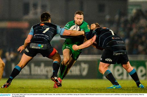 Jack Carty of Connacht is tackled by Ellis Jenkins, left, and Rhys Gill of Cardiff Blues