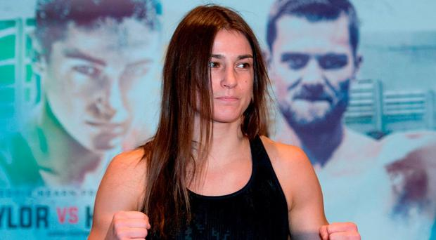 Katie Taylor is ready for action at yesterday's official weigh-in at the Hilton London Wembley Hotel ahead of her professional debut tonight. Photo: Stephen McCarthy/Sportsfile