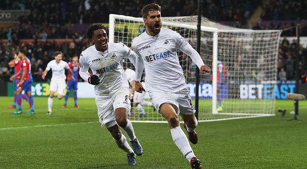 SWANSEA, WALES - NOVEMBER 26: Fernando Llorente of Swansea City celebrates scoring his team's fifth goal during the Premier League match between Swansea City and Crystal Palace at Liberty Stadium on November 26, 2016 in Swansea, Wales. (Photo by Christopher Lee/Getty Images)