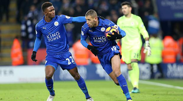 LEICESTER, ENGLAND - NOVEMBER 26: Islam Slimani of Leicester City celebrates with Demarai Gray of Leicester City after scoring from the penalty spot to make it 2-2 during the Premier League match between Leicester City and Middlesbrough at King Power Stadium on November 26 , 2016 in Leicester, United Kingdom. (Photo by Plumb Images/Leicester City FC via Getty Images)