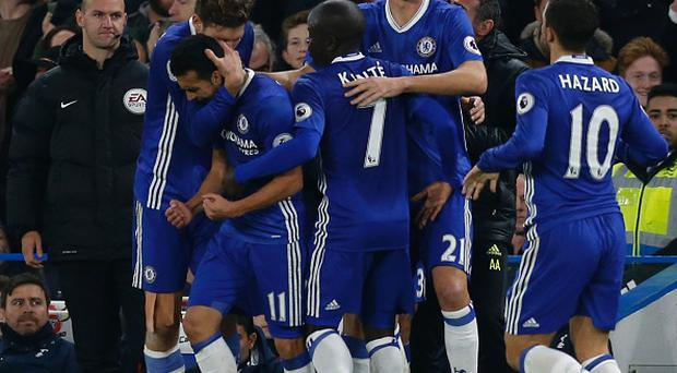 Chelsea's Spanish midfielder Pedro (2L) celebrates scoring their first goal to equalise 1-1 during the English Premier League football match between Chelsea and Tottenham Hotspur at Stamford Bridge in London on November 26, 2016. / AFP / Ian KINGTON / RESTRICTED TO EDITORIAL USE. No use with unauthorized audio, video, data, fixture lists, club/league logos or 'live' services. Online in-match use limited to 75 images, no video emulation. No use in betting, games or single club/league/player publications. / (Photo credit should read IAN KINGTON/AFP/Getty Images)