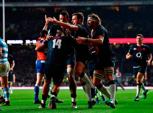 England's Jonny May celebrates with team mates after he scored his sides second try. Photo: Getty