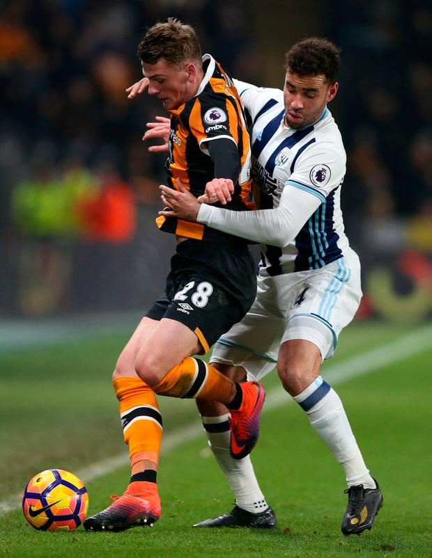 Hull City's Josh Tymon tussels with West Bromwich Albion's Hal Robson-Kanu during the match at The Kingston Communications Stadium. Photo: Scott Heppell/Reuters
