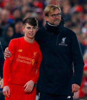 Jurgen Klopp with debutant Ben Woodburn as he prepares to come on. Photo: Phil Noble/Reuters