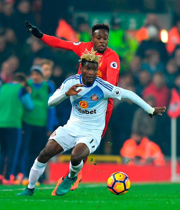 Sunderland's Didier Ibrahim Ndong (left) and Liverpool's Divock Origi battle for the ball during the Premier League match at Anfield. Photo: Dave Howarth/PA