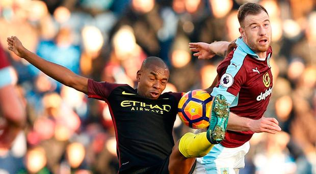 Burnley's Ashley Barnes battle for the ball with Manchester City's Fernando durng the match at Tuirf Moor. Photo: Andrew Yates/Reuters