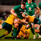Tadhg Furlong is tackled by Australia's Reece Hodge and Dean Mumm. Photo: Brendan Moran/Sportsfile