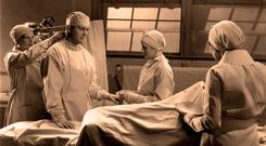 PAST PROCEDURE: Surgeons at work in the operating theatre in an archive image. Picture posed by models.
