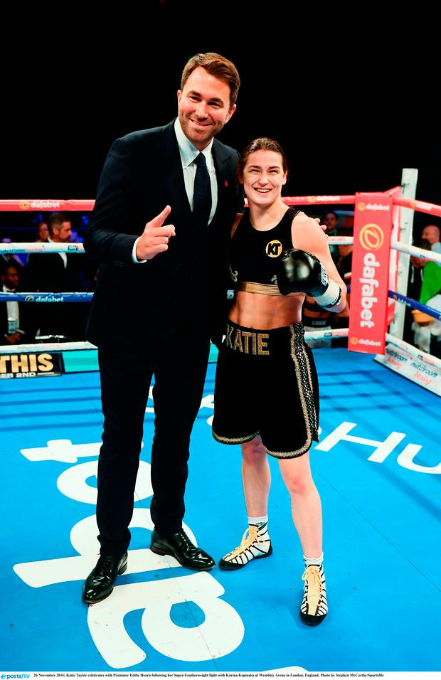 Katie Taylor celebrates with Promoter Eddie Hearn following her Super-Featherweight fight with Karina Kopinska at Wembley Arena in London, England. Photo by Stephen McCarthy/Sportsfile