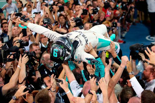 Mercedes' Nico Rosberg celebrates winning the Formula One world championship during the Abu Dhabi Grand Prix at the Yas Marina Circuit, Abu Dhabi. PRESS ASSOCIATION Photo. Picture date: Sunday November 27, 2016. See PA story AUTO Abu Dhabi. Photo credit should read: David Davies/PA Wire. RESTRICTIONS: Editorial use only. Commercial use with prior consent from teams.