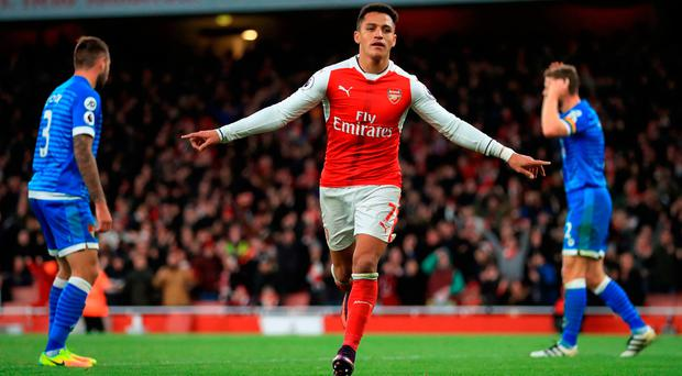 Arsenal's Alexis Sanchez celebrates scoring his side's third goal of the game during the Premier League match at Emirates Stadium, London. PRESS ASSOCIATION Photo. Picture date: Sunday November 27, 2016. See PA story SOCCER Arsenal. Photo credit should read: John Walton/PA Wire. RESTRICTIONS: EDITORIAL USE ONLY No use with unauthorised audio, video, data, fixture lists, club/league logos or