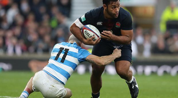 LONDON, ENGLAND - NOVEMBER 26: Billy Vunipola of England is held by Juan Pablo Estelles during the Old Mutual Wealth Series match between England and Argentina at Twickenham Stadium on November 26, 2016 in London, England. (Photo by David Rogers - RFU/The RFU Collection via Getty Images)