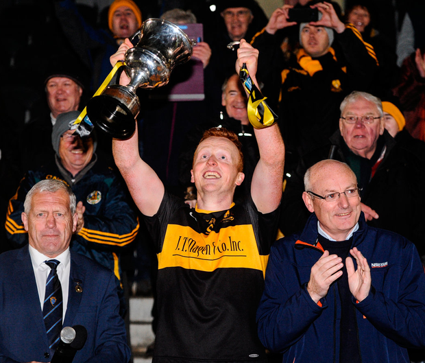 A handle breaks off the cup as Dr Crokes captain Johnny Buckley lifts the cup after the AIB Munster GAA Football Senior Club Championship Final. Photo: Diarmuid Greene/Sportsfile