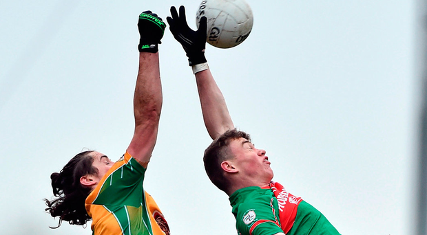 Corofin's Kieran Molloy in an aerial duel with Conor Murray of St Brigid's. Photo: David Maher/Sportsfile