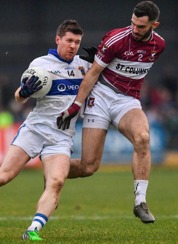Enda Varley of St. Vincent's battles with Simon Cadam of St. Columba's. Photo: Ramsey Cardy/Sportsfile